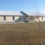 South Fork Home Has Wood Siding Two Car Garage Bedrooms