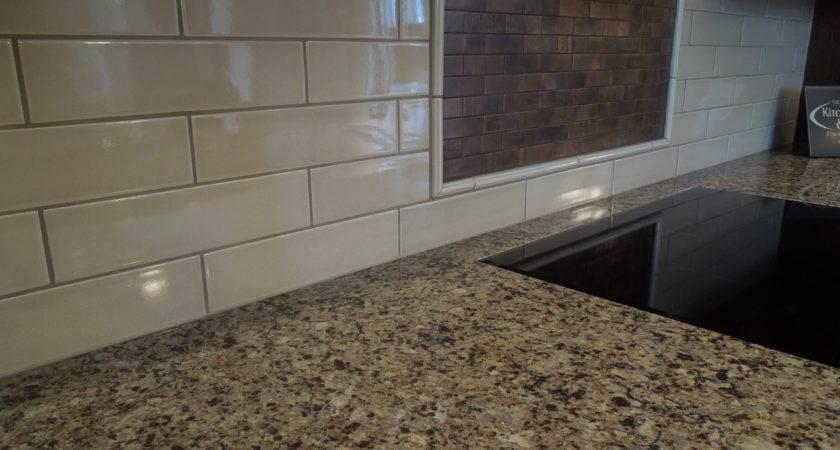 Subway Tile Metallic Accent Above Cooktop